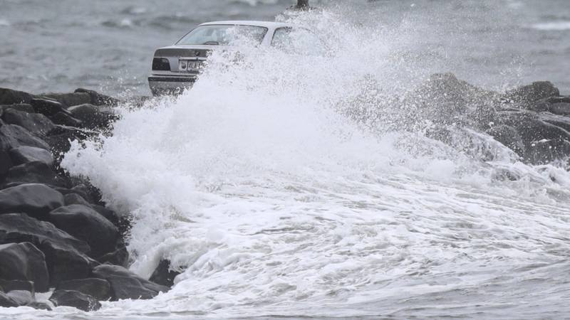A car making its way across the Gooseberry Island causeway, Tuesday, Oct. 26, 2021, in...