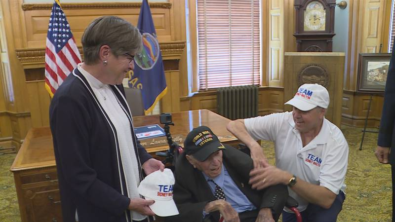 WWII Vet Sidney Walton, 102, on a 50-state, 50-governor tour, visited Gov. Laura Kelly Tuesday.