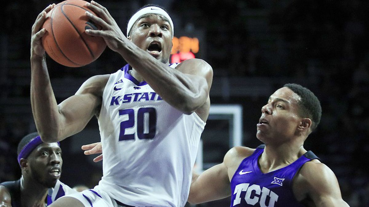 Kansas State forward Xavier Sneed (20) drives past TCU guard Desmond Bane (1) during the second...