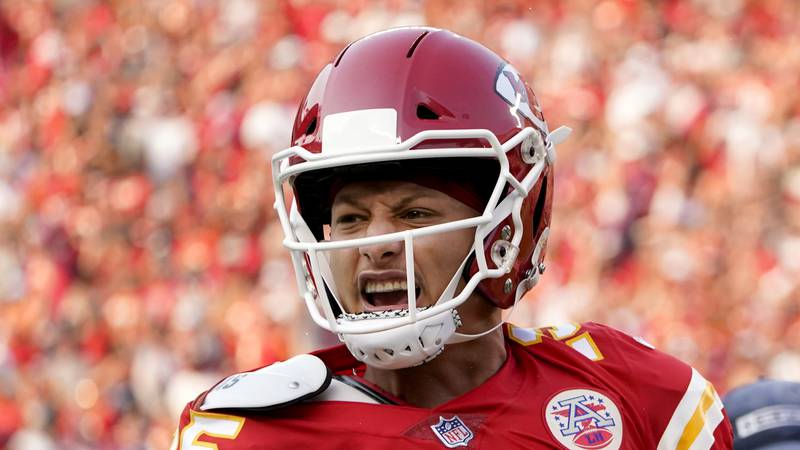 Kansas City Chiefs quarterback Patrick Mahomes celebrates after throwing a touchdown pass...
