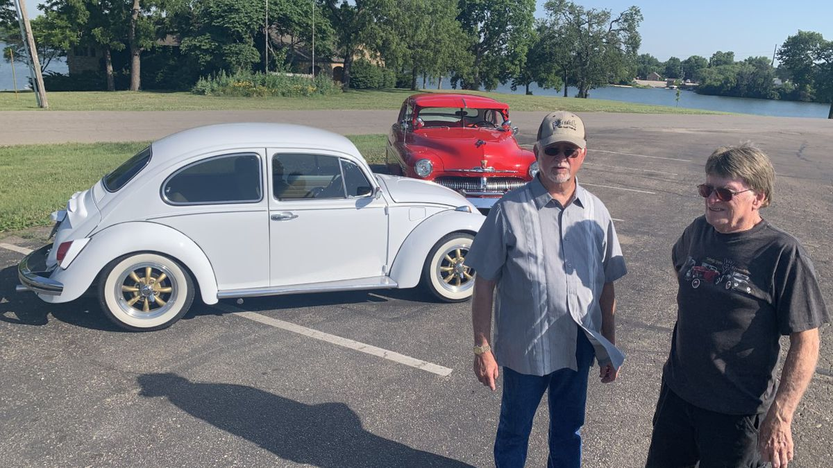 Ed White, left, and Bud Mallory discuss the annual car show set for 8 a.m. to 3 p.m. Saturday, July 4, near Reynolds Lodge, 3315 S.E. Tinman Circle on the east side of Lake Shawnee. White is standing near his white 1969 Volkswagen Beetle while Mallory is standing near his red 1950 Mercury two-door coupe.