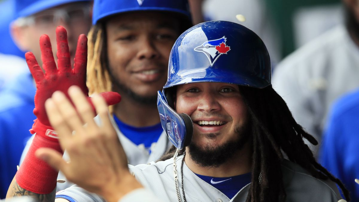 Toronto Blue Jays designated hitter Freddy Galvis is congratulated by teammates after his solo home run during the seventh inning of a baseball game against the Kansas City Royals at Kauffman Stadium in Kansas City, Mo., Wednesday, July 31, 2019. (AP Photo/Orlin Wagner)