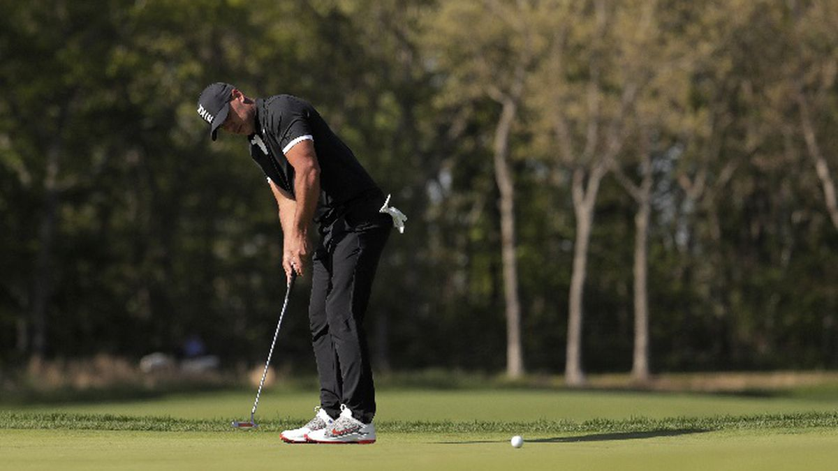 Brooks Koepka putts on the ninth green during the third round of the PGA Championship golf tournament, Saturday, May 18, 2019, at Bethpage Black in Farmingdale, N.Y. (AP Photo/Julio Cortez)