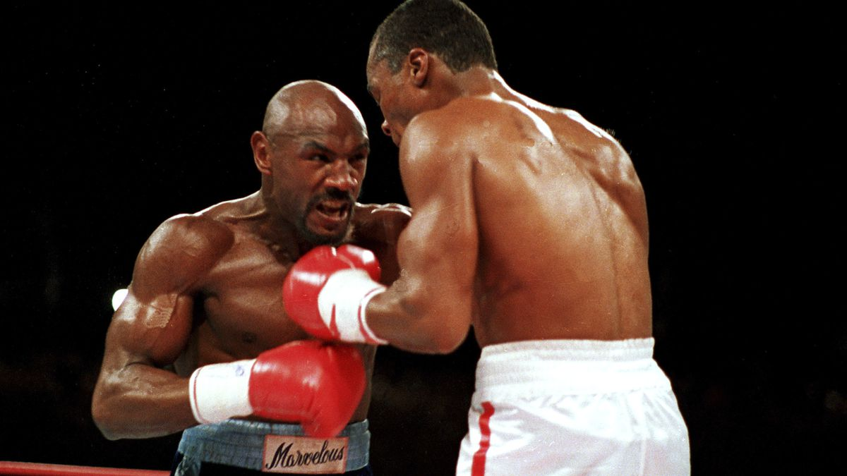 "FILE - In this April 1987 file photo, ""Marvelous"" Marvin Hagler, left, moves in on ""Sugar"" Ray..."