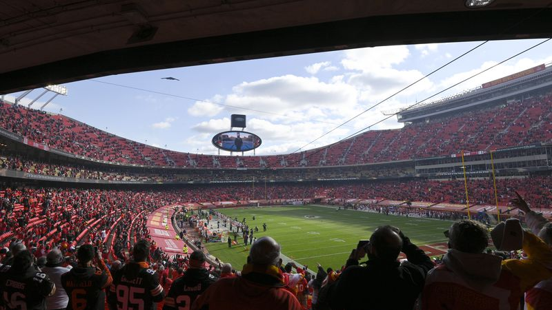 Fans cheer in Arrowhead Stadium during a flyover before an NFL divisional round football game...