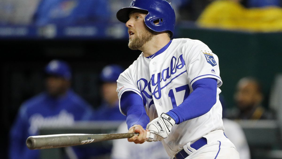 Kansas City Royals' Hunter Dozier watches his two-run triple against the Los Angeles Angels in the fifth inning of a baseball game at Kauffman Stadium in Kansas City, Mo., Saturday, April 27, 2019. (AP Photo/Colin E. Braley)
