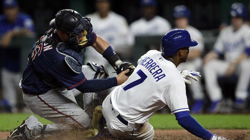 Minnesota Twins catcher Bobby Wilson, left, tags out Kansas City Royals' Rosell Herrera (7)...