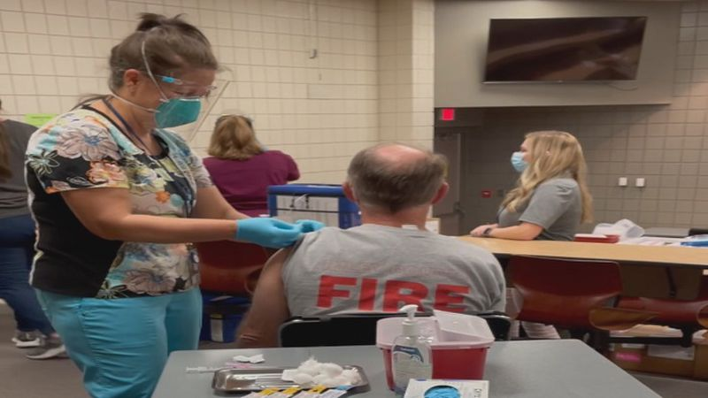 Riley County community member receiving COVID-19 vaccine, photo provided by Riley County,...