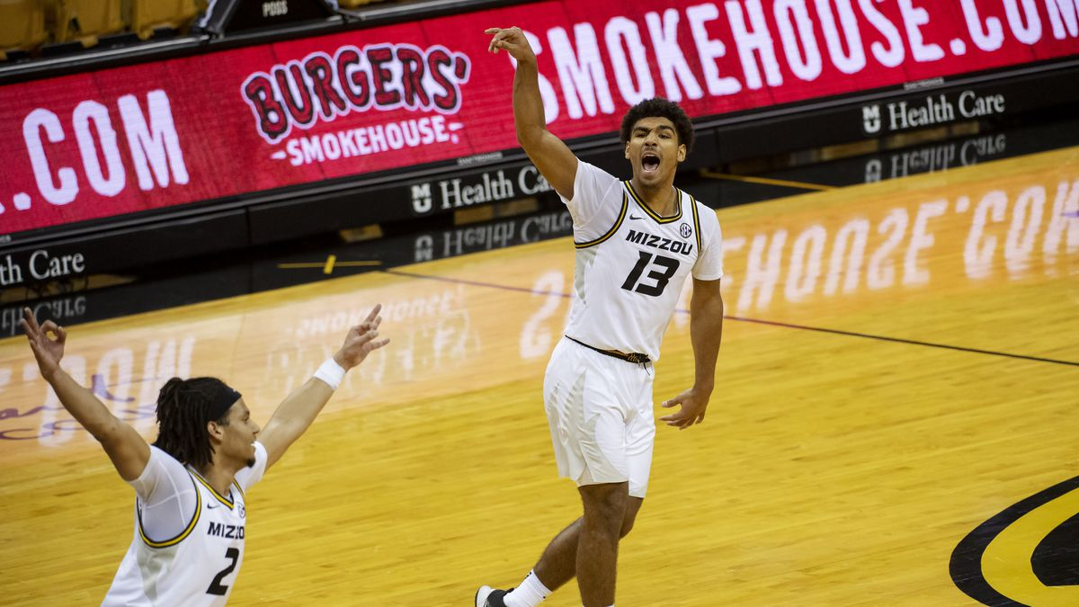 Missouri's Mark Smith, right, celebrates his three point basket with teammate Drew Buggs during...
