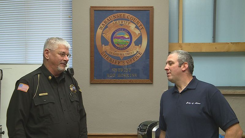 Major Sam Hamilton of the Wabaunsee Co. Sheriff's Office (L) and Michael Slobodnik (R) of Fire...