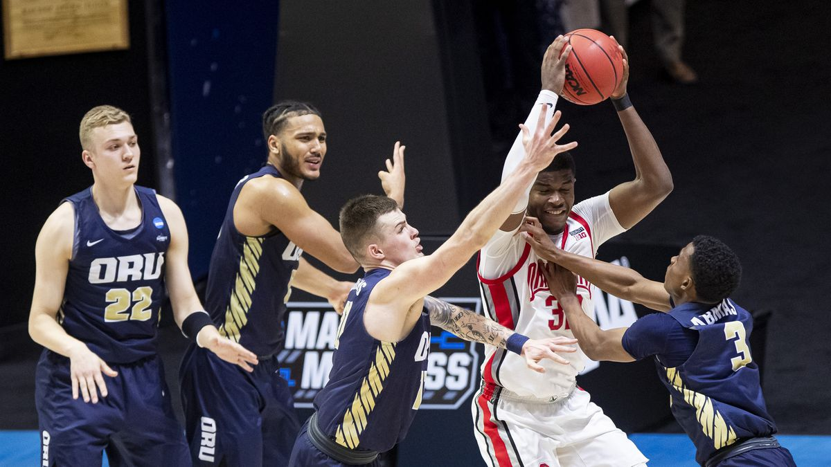 Ohio State's E.J. Liddell, second from right, gets pressure from Oral Roberts' Francis Lacis...