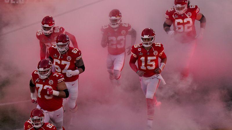 Kansas City Chiefs' Patrick Mahomes (15) and teammates run onto the field before the NFL Super...