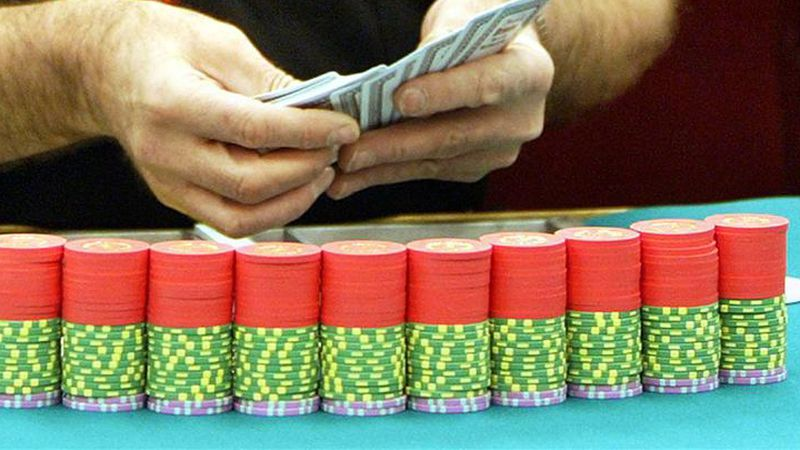 Dealer sets up poker table