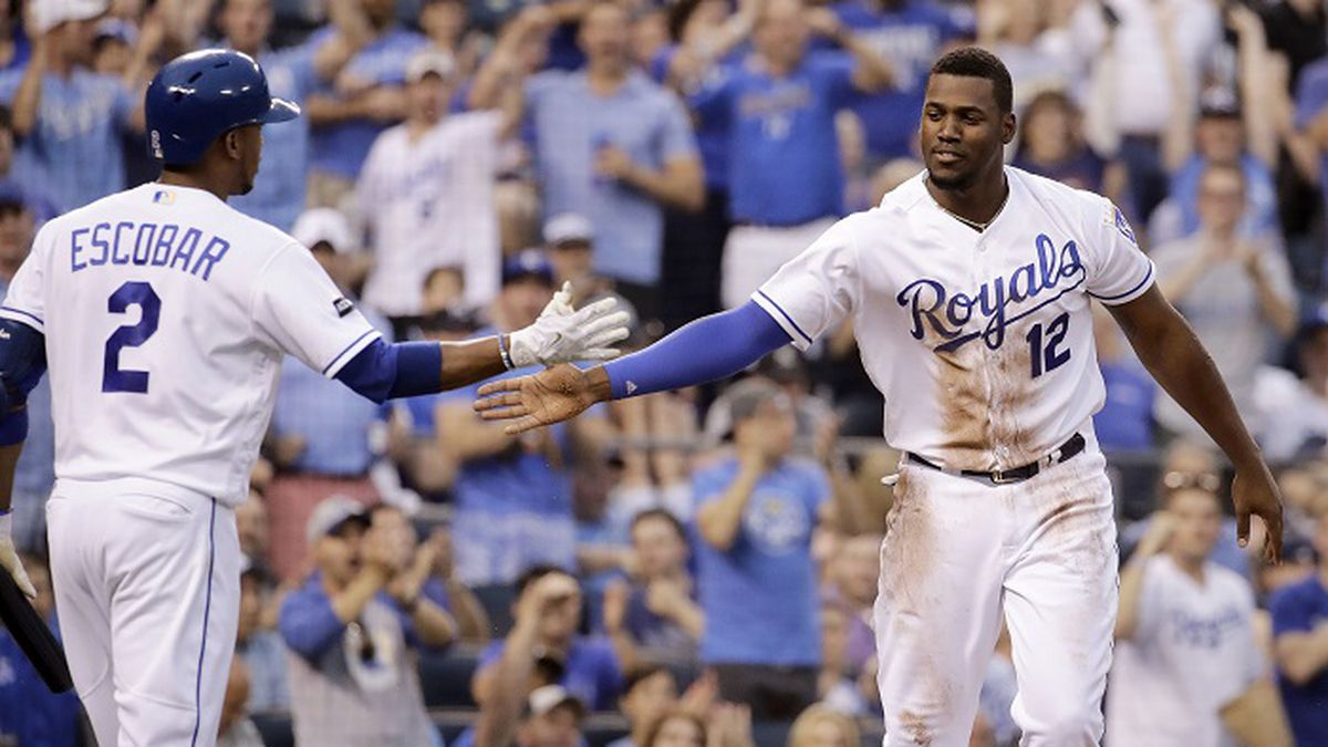 Kansas City Royals' Jorge Soler (12) celebrates with Alcides Escobar (2) after scoring on a single by Drew Butera during the second inning of a baseball game New York Yankees Thursday, May 18, 2017, in Kansas City, Mo. (AP Photo/Charlie Riedel)
