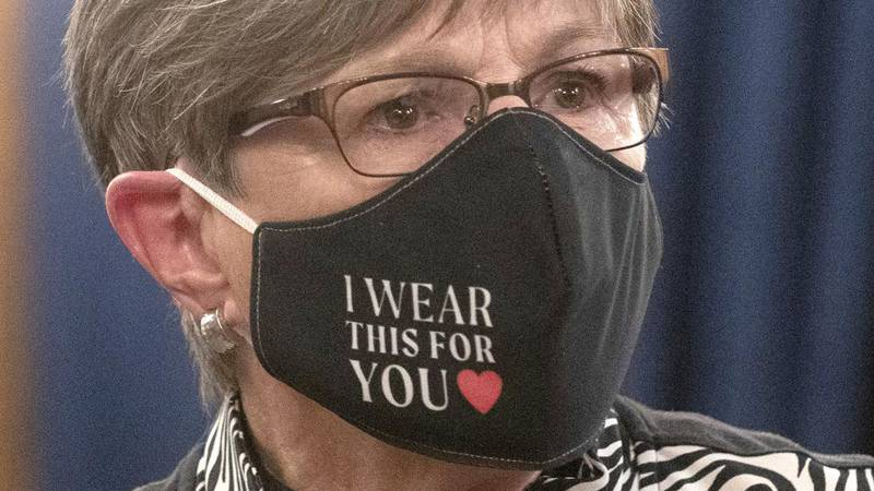 FILE - In this July 2020, file photo, Kansas Gov. Laura Kelly wears a protective mask during a...