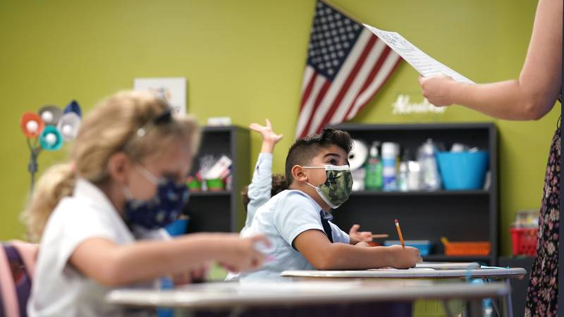 A student listens to the teacher's instructions on the first day of school, Monday, Aug. 23,...