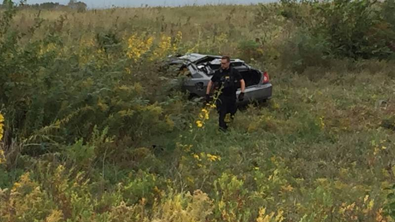 Officers work a single-car accident in which they say one person was ejected from the vehicle...
