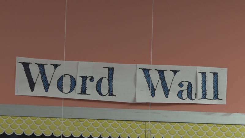 """USD 501 school having a """"Word Wall"""" sign at their Cinco De Mayo celebrations."""