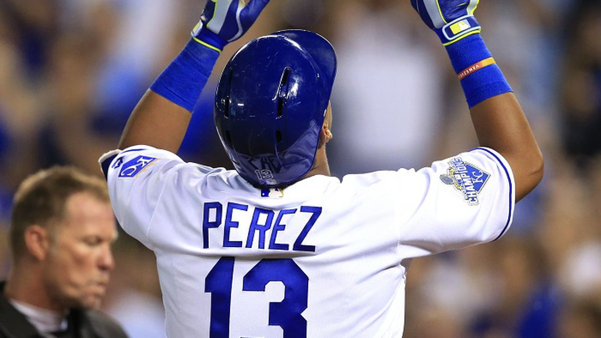 Kansas City Royals' Salvador Perez celebrates his two-run home run off Cleveland Indians relief pitcher Bryan Shaw during the eighth inning of a baseball game at Kauffman Stadium in Kansas City, Mo., Tuesday, June 14, 2016. The Royals defeated the Indians 3-2. (AP Photo/Orlin Wagner)