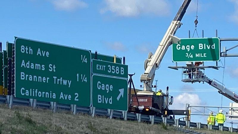 KDOT crews installing new signs over I-70