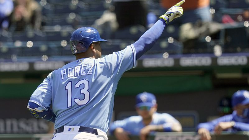 Kansas City Royals'wld Salvador Perez gestures while rounding the bases during the third inning...