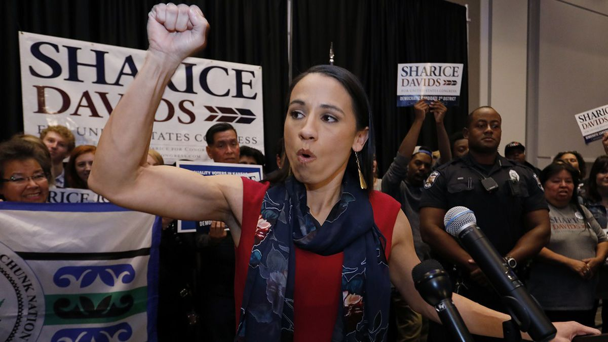 Democrat house candidate Sharice Davids reacts as she gives a victory speech to supporters at a...