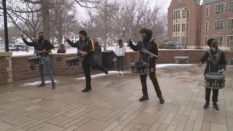 Topeka High Drum Line performs as students leave