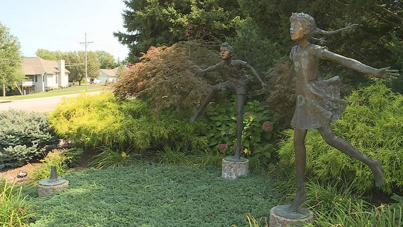 Part of the Spring Dance statue at 37th and Spring Woods was stolen