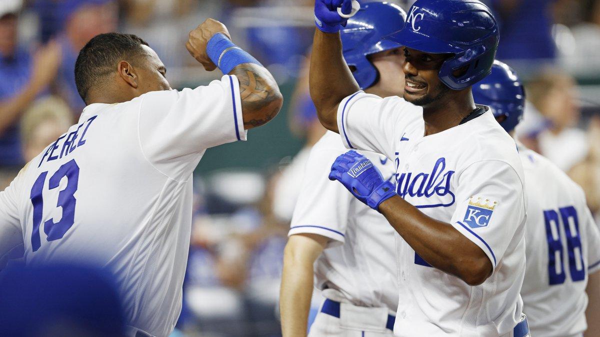 Kansas City Royals' Salvador Perez (13) congratulates Michael A. Taylor, right, after hitting a...