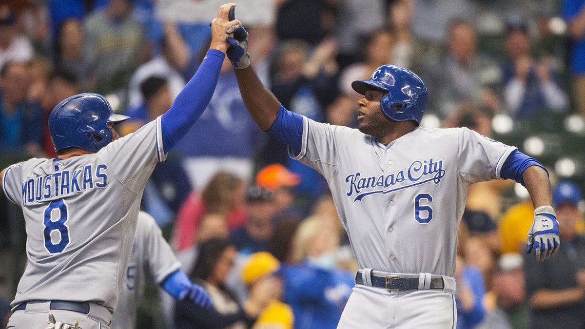 Kansas City Royals' Mike Moustakas, left, greats Lorenzo Cain at home after Cain hit a two-run home run off of Milwaukee Brewers' Matt Garza during the first inning of a baseball game Tuesday, June 16, 2015, in Milwaukee. (AP Photo/Tom Lynn)