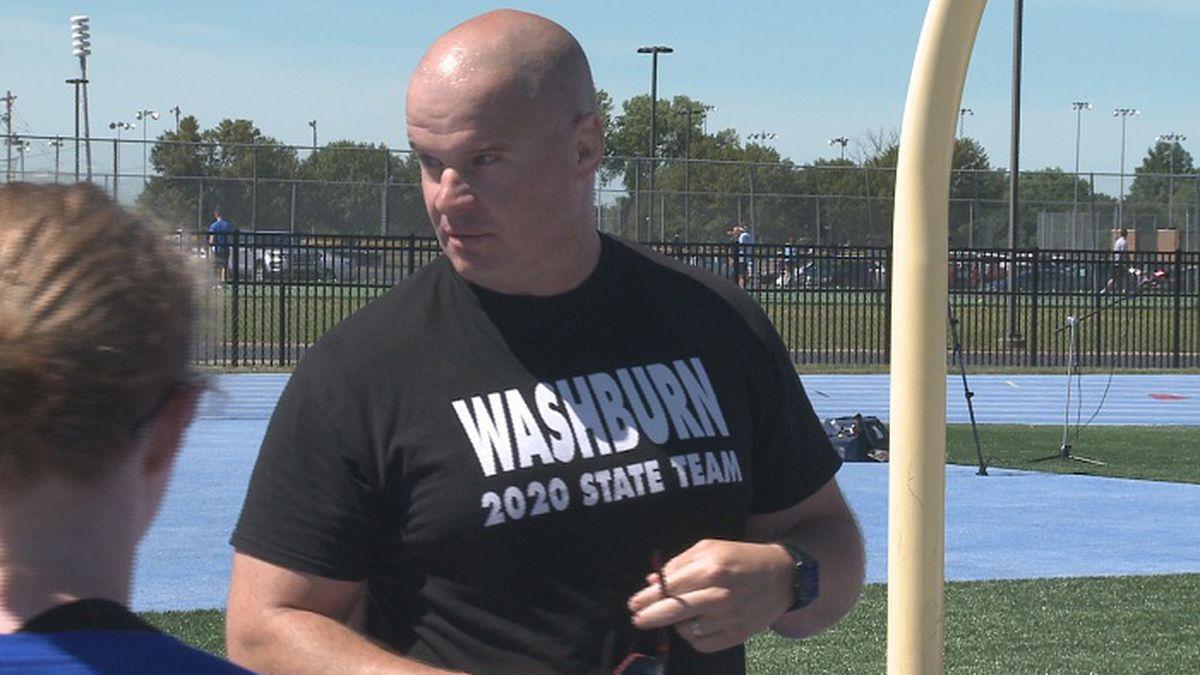 Washburn Rural wrestling coach Damon Parker instructed the Junior Blues girls wrestling team...