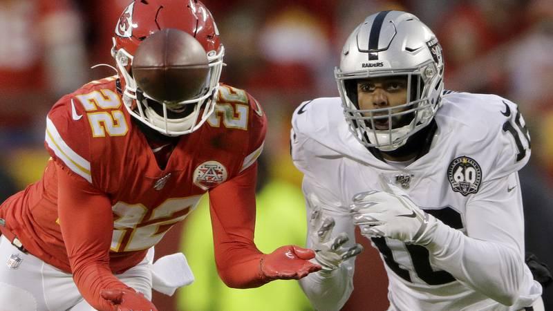 Kansas City Chiefs safety Juan Thornhill (22) intercepts a pass intended for Oakland Raiders...