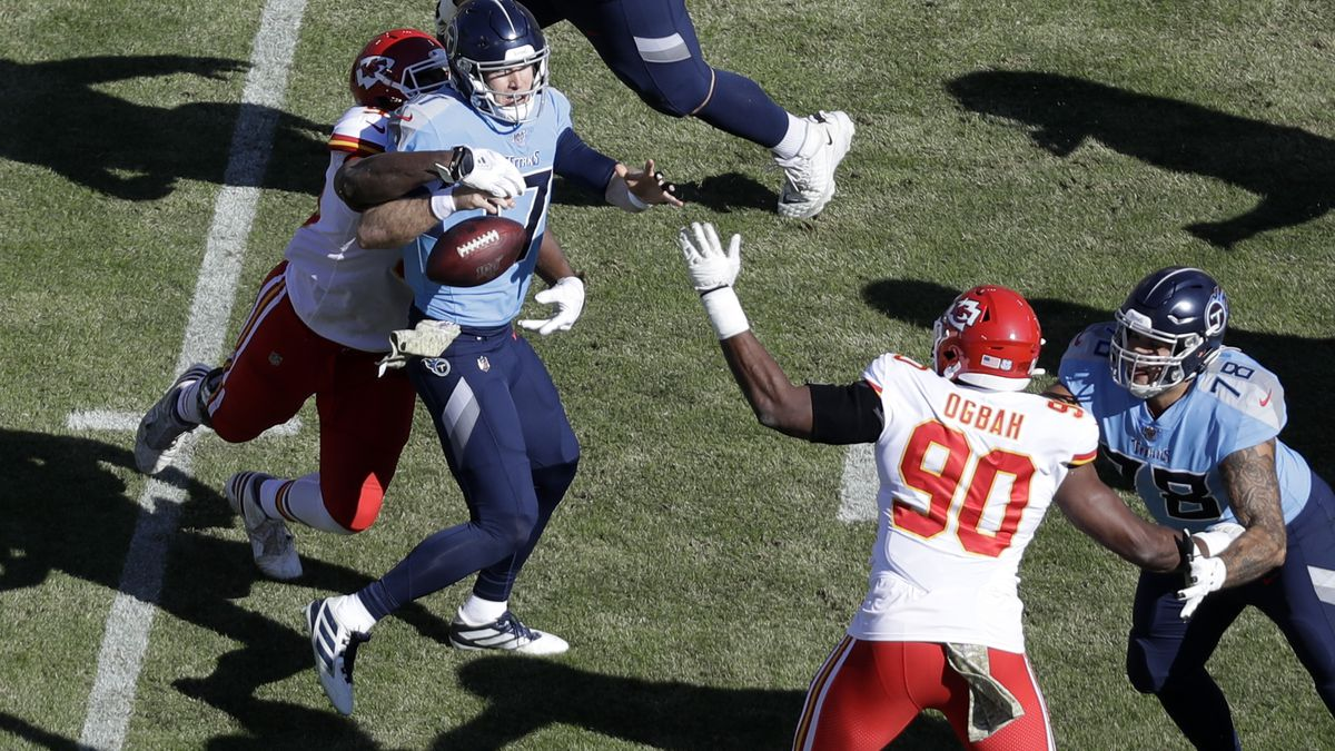 Tennessee Titans quarterback Ryan Tannehill (17) fumbles the ball as he is hit by Kansas City Chiefs defensive end Chris Jones in the first half of an NFL football game Sunday, Nov. 10, 2019, in Nashville, Tenn. The Chiefs recovered the ball. (AP Photo/James Kenney)