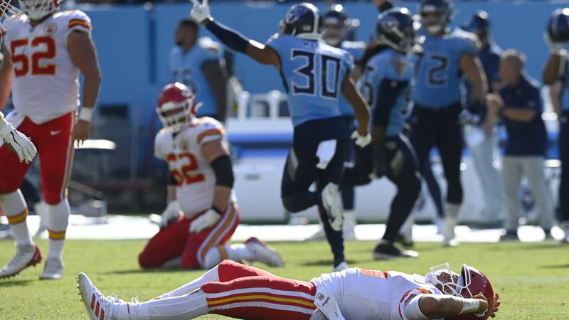 Kansas City Chiefs quarterback Patrick Mahomes lies on the field after being hit in the second...