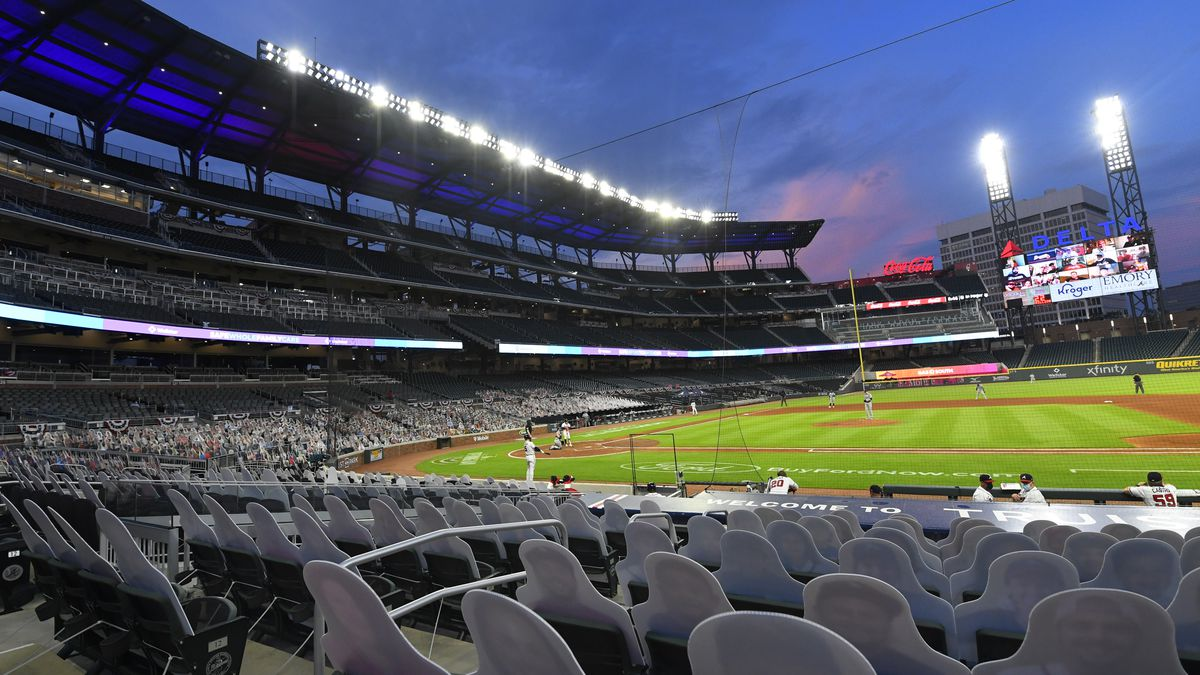FILE - Cardboard cutouts of fans in the otherwise empty seats face the field during the sixth...