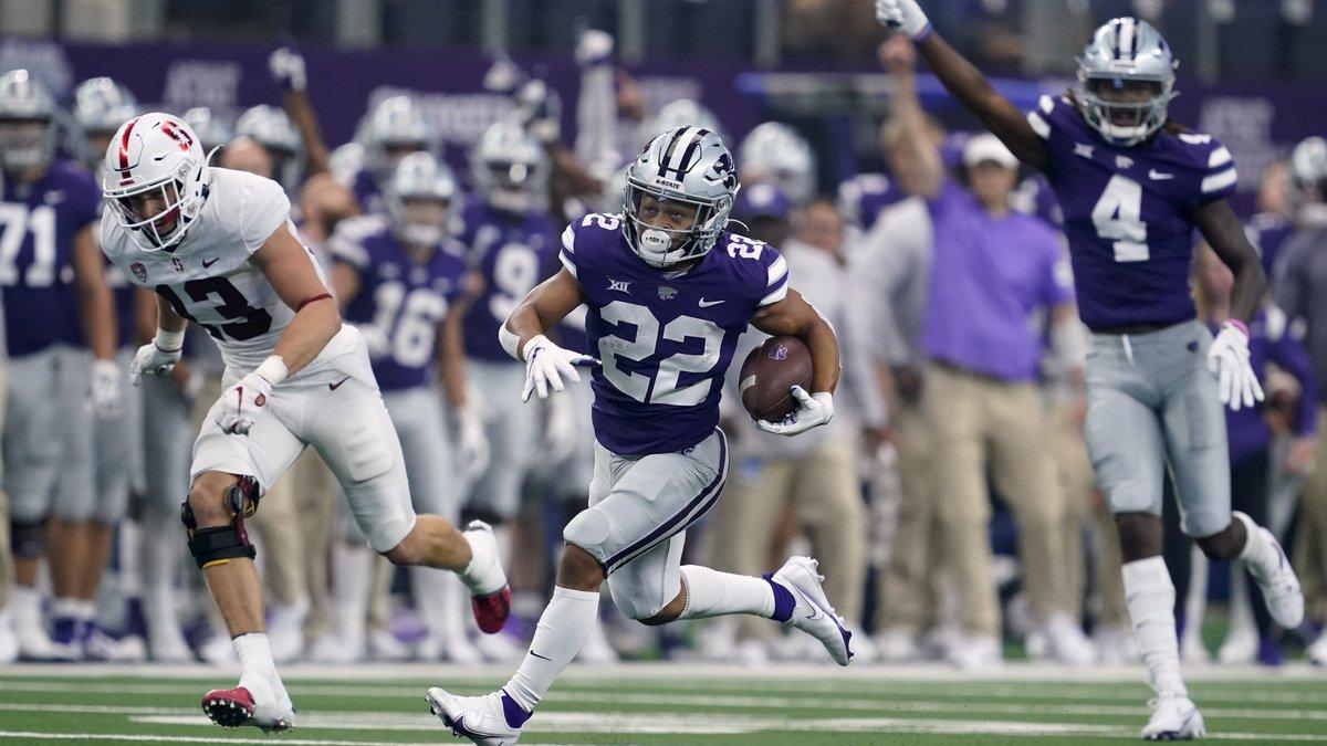 Kansas State running back Deuce Vaughn (22) is cheered on by wide receiver Malik Knowles (4) as...