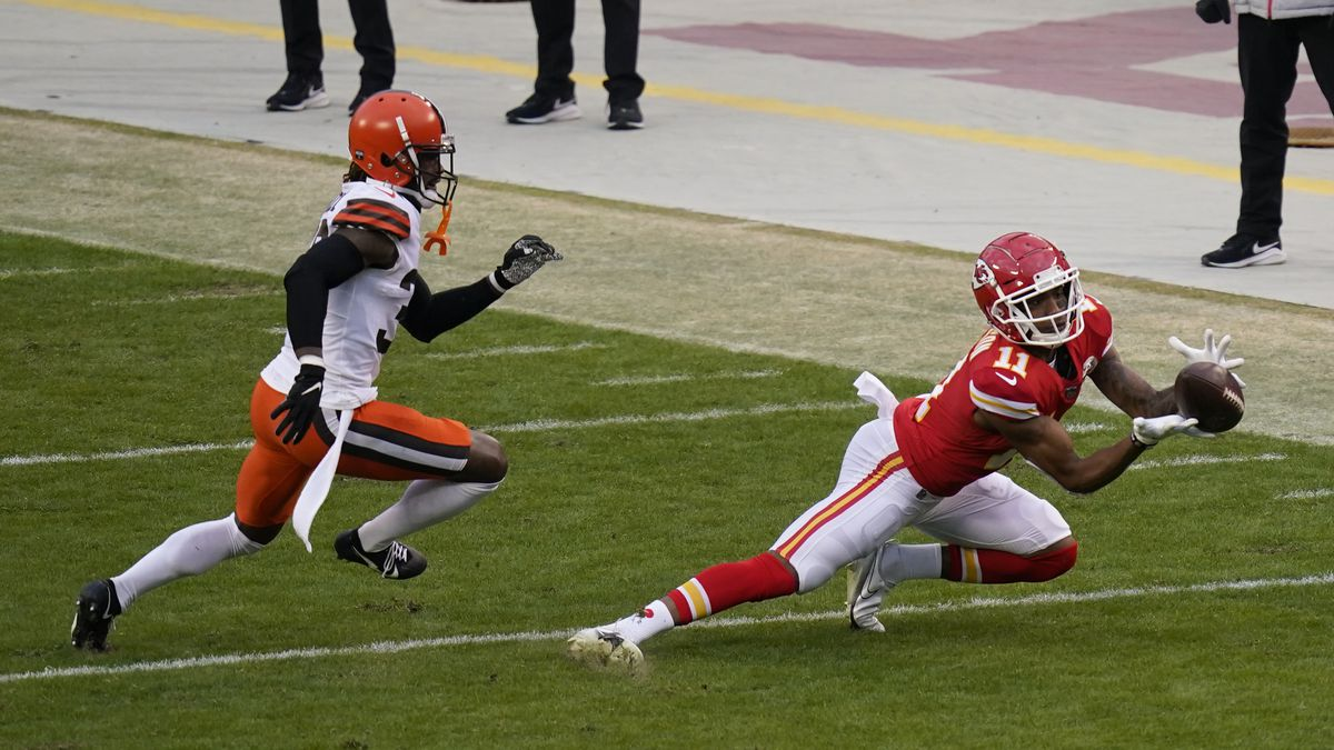 Kansas City Chiefs wide receiver Demarcus Robinson (11) catches a pass ahead of Cleveland...