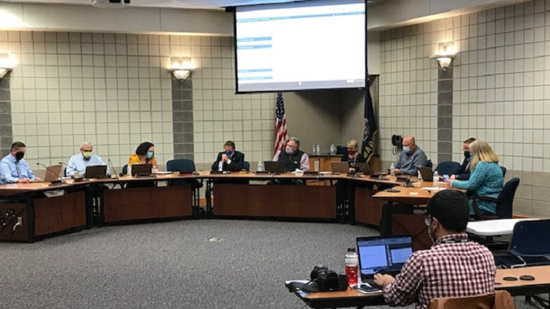 USD 437 Board of Education members consider an objection to the district's facemask requirement...