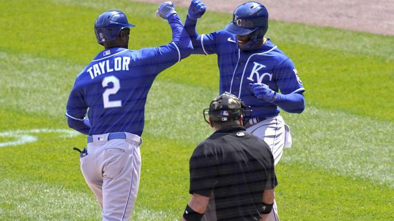 Kansas City Royals' Michael A. Taylor (2) celebrates with Jorge Soler after they scored on...
