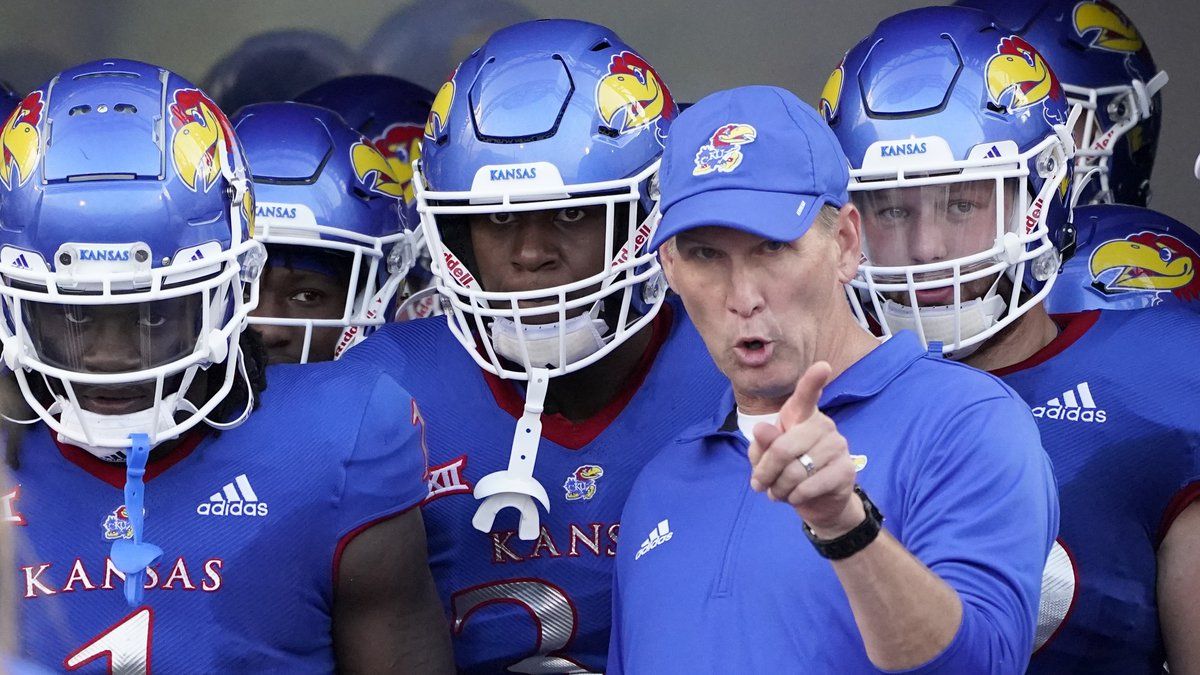 Kansas head coach Lance Leipold talks to his players before an NCAA college football game...