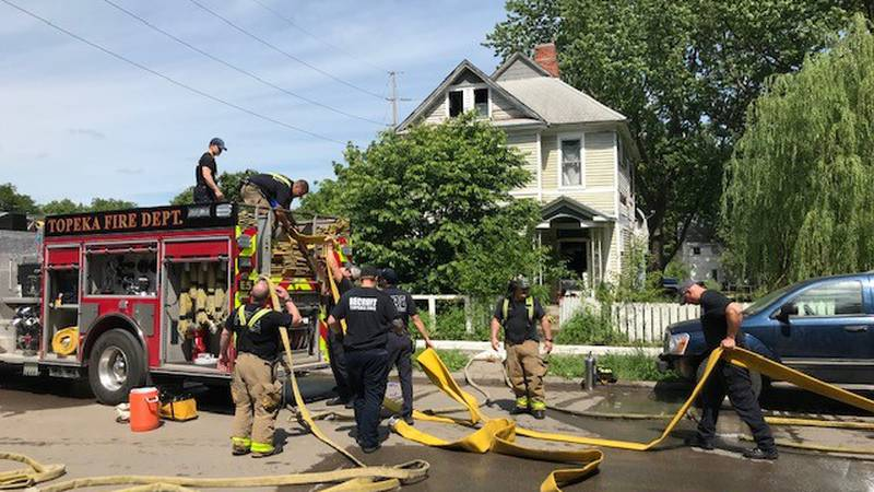 Topeka firefighters battle a blaze at 1600 SW Clay St. on June 3, 2021.