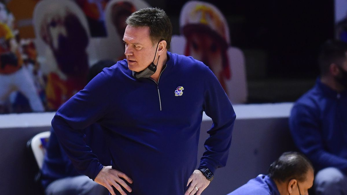 Kansas coach Bill Self looks over during the team's NCAA college basketball game against...