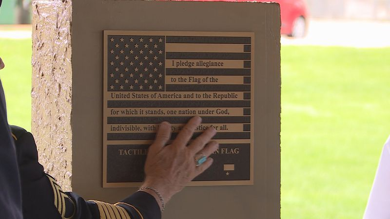 On National Flag Day, Governor Kelly helped honor blind veterans with a flag of their own.