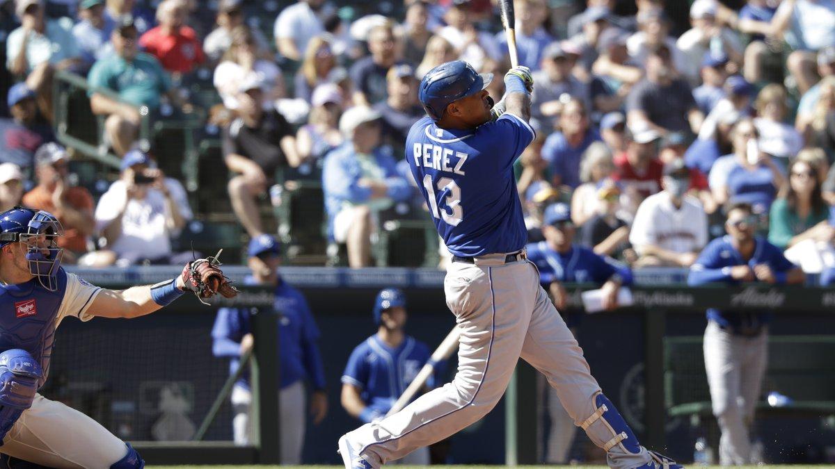 Kansas City Royals' Salvador Perez (13) hits a home run as Seattle Mariners catcher Cal...