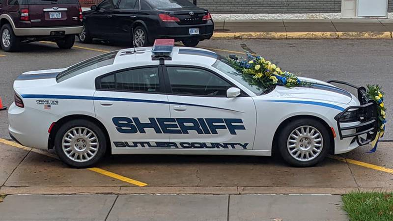 The Butler County Sheriff's Office placed flowers on the patrol car of Deputy Stephen Evans who...