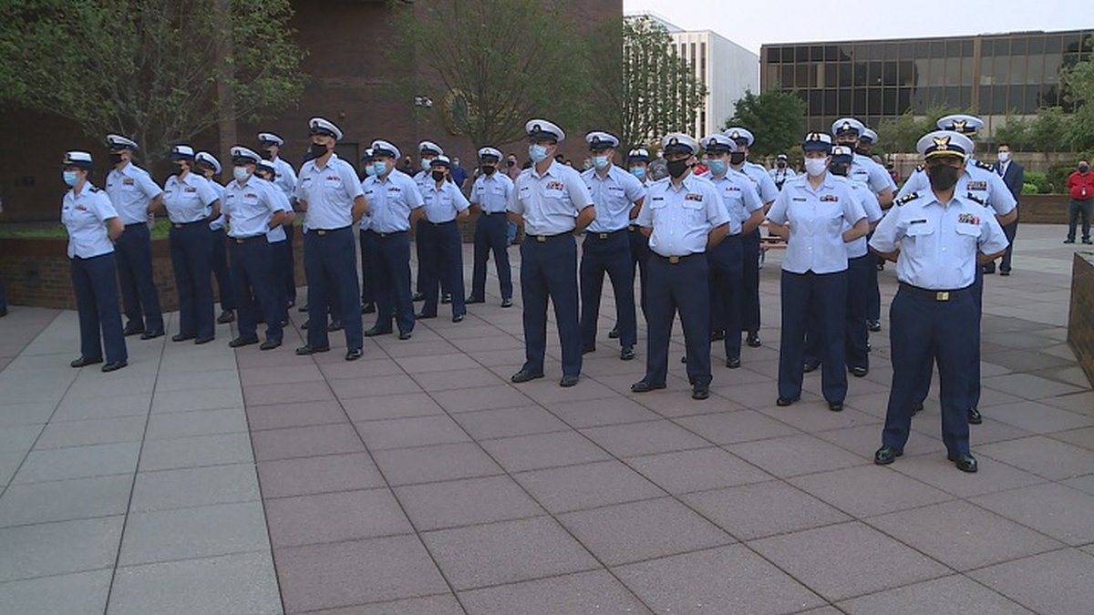 The Kansas Coast Guard stand at attention recognizing the victims of 9/11