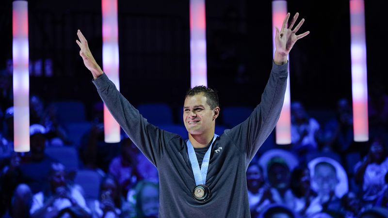Michael Andrew reacts at the medal ceremony after winning the Men's 100 Breaststroke during...