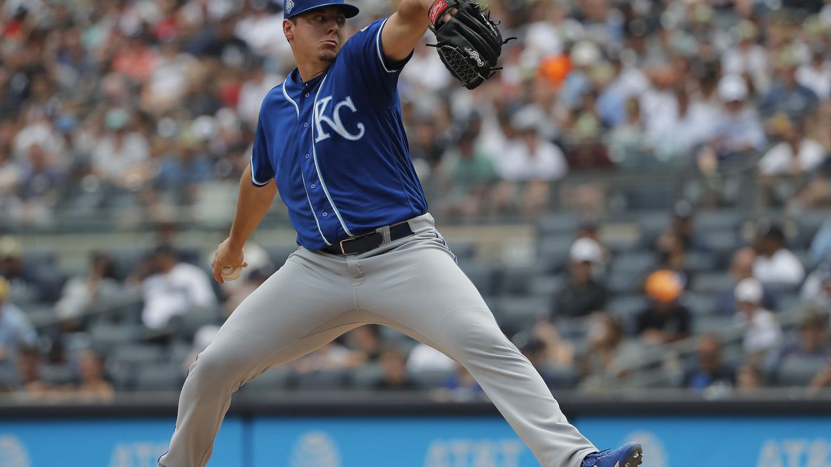 Kansas City Royals pitcher Brad Keller delivers against the New York Yankees during the first...