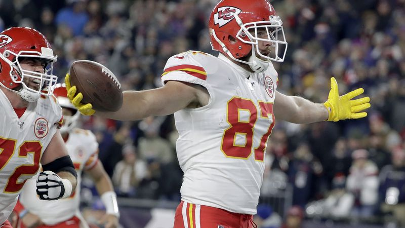 Kansas City Chiefs tight end Travis Kelce, left, celebrates his touchdown in the first half of...