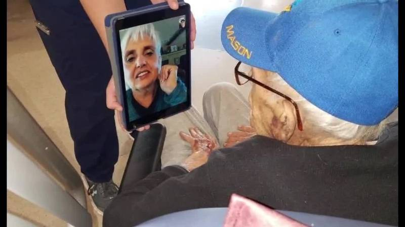 FILE - A veteran video chats with his loved one as the COVID-19 pandemic keeps visitors out of...